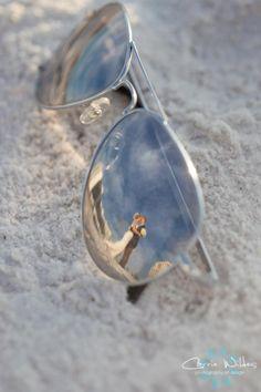 a389c9c825 Nice wedding shot reflected in mirrored sunglasses. Wedding Sunglasses