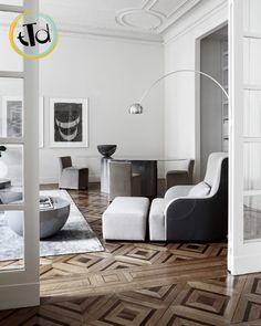 l'effetto di un PARQUET così geometrico, in un soggiorno semplice ed elegante, è davvero sorprendente