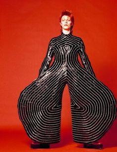 David Bowie wearing a striped bodysuit by Kansai Yamamoto
