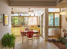 Yellow Cabinets Kitchen and painted floor tiles, Tel Aviv Kitchen Dining, Kitchen Cabinets, Yellow Cabinets, Painting Tile Floors, Tiles, Windows, Flooring, Tel Aviv, Sculptures