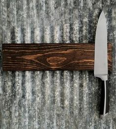 Walnut Magnetic Knife Rack by Coffee Diem Dry Goods. With rich, dark walnut, this knife rack features a solid strip of strong rare earth magnets to hold your knives.