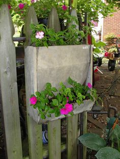Barn Al made this planter from and old chicken feeder...