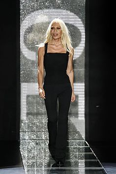 Donatella Versace is one of fashion's survivors - not least for enduring the misery of her brother Gianni's murder on July 15 1997 - she had always been his muse and he dedicated perfume Blonde to her and her famed platinum mane.  She has kept Versace as a major player in the fashion stakes since his death, whilst publicly emerging from her own addiction issues.