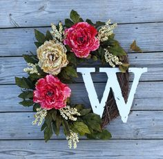 This wreath makes a perfect gift for a birthday, housewarming or even Mothers Day. Also perfect year round on your front door! This wreath is
