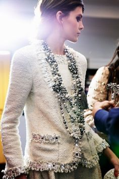 A tweed jacket with layered Chanel Necklaces, how can you go wrong?