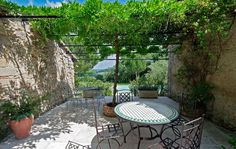 Courtyard / patio garden at 300 year old farmhouse in France.