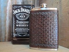 Done in a traditional western basket weave pattern, this generous 8 ounce leather covered stainless flask is a perfect gift for that special someone.  The flask is completely crafted by hand using traditional saddle maker methods.    Color: Dark Brown  If you would like a custom-made version ...