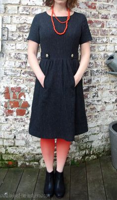 Simplicity 1652 in pinstripe cotton/linen via Behind the Hedgerow   Have to admit that the dress does not look this good with Simplicity's sample! Really lovely use of fabric.