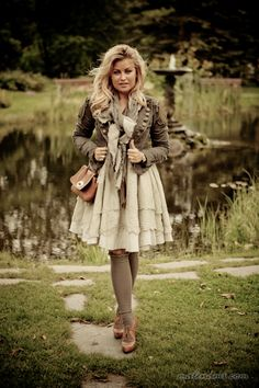 She looks adorable, but I thoroughly dislike chicks with longer hair worn down also wearing scarves... it's similar to long legs being truncated by the abomination known as booties.