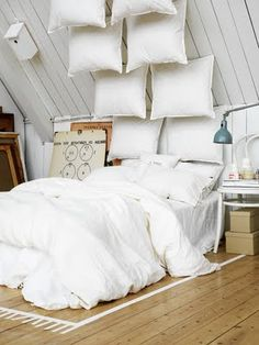 What do you think about hanging pillows from the ceiling? A new headboard option?