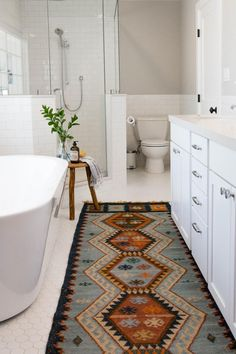 Would you ever believe this bathroom used to be a garage?! Designed from scratch, the so-chic space now offers a two-person, walk-in shower, a double vanity and luxurious soaking tub. The toilet is tucked in behind the bathroom door for extra privacy.