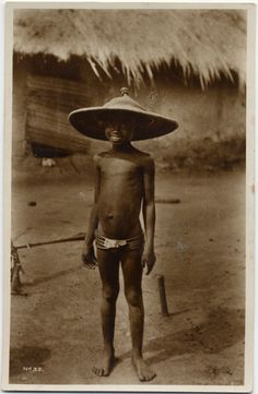 """Young African boy with large hat, Ghana, n.d. Missionary Postcards   Yale University Divinity School Library   New Haven, CT,  2006      Postcard shows a smiling boy in a hat with a wide brim. The front is marked """"No. 35."""" The back is labeled """"Copyright of Methodist Book Depots, Cape Coast, Gold Coast.""""Digitized from a postcard in Record Group No. 101, Special Collections, Yale University Divinity School Library.  Missions--Ghana.   Methodist Missionary Society."""