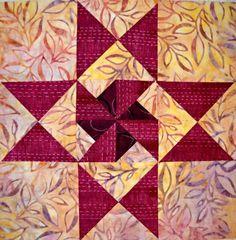 Pinwheel Star Quilt Block - pinwheels with dark background and hourglass blocks