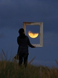 """Playing With The Moon In Photos    These pictures taken by amateur astronomer turned photographer Laurent Laveder show people painting, throwing, catching and bouncing the moon. Combining his love for astronomy and photography, physics graduate Laurent created the collection called """"Moon Games"""" on a beach near his home in France."""