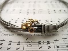 Recycled Electric Guitar String Bracelet silver colored with brass ball ends attached Unisex