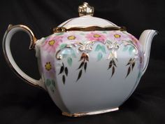 A lovely Sadler cube teapot with pink flowers and gold leaves.
