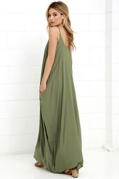 Lulus Exclusive! Every flower in the garden won't compare to you in the Garden Charmer Olive Green Maxi Dress! This simple, gauzy rayon maxi has a relaxed triangle bodice, adjustable spaghetti straps, and hidden front pockets on a breezy, Boho skirt.
