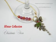 """Christmas Jewelry ~ A must-have stunning 24"""" Necklace to wear out for a night of Christmas shopping, dinner with that special someone or to wear with your new Christmas outfit! A Christmas Fern Charm & a White Glass Pearl Acorn dangle from an Antique Gold Tone Circle with 5 Crimson Czech Glass Flat Cut Beads to accent the front Toggle Clasp. Visit my Etsy shop @ www.TouchedByGod.etsy.com!"""