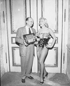 """Marilyn receiving a prize as """"The Most Popular Actress of Arkansas"""" from Roscoe Ates in January 26, 1953"""
