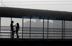 People talk on a foot bridge in heavy smog in Delhi, India, November 10, 2017. REUTERS/Cathal McNaughton via @AOL_Lifestyle Read more: https://www.aol.com/article/news/2017/11/20/un-north-korean-women-suffer-discrimination-rape-and-malnutrition/23283131/?a_dgi=aolshare_pinterest#fullscreen