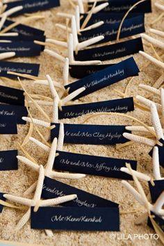 Starfish and navy place cards for beach themed wedding #MaineWeddings. http://www.fostersclambake.com #BeachThemedWeddings