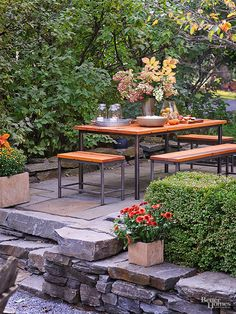 This dining table features a modern twist on the traditional picnic table. Movable bench seating is particularly practical for squeezing additional guests around the table./