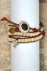 """Ruth""    This attractive ochre leather wrap is a fabulous year round look with crystal accented bronze cross charms and faceted creamy beads. Wrapping around your wrist three times with a decorative button clasp, this is a fun and trendy accessory.  Like Ruth, emulate Christ's loving redemption and be a bearer of His kindness"
