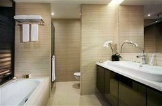 hotel bathrooms pictures   Pan Pacific Serviced Suites - Singapore - Room - Living Area: