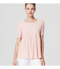 An irresistibly textured ottoman knit meets a smooth peplum hem for a fresh femme twist. Round neck. Short sleeves.