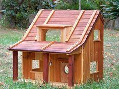 wooden dollhouse by Carla de Jong