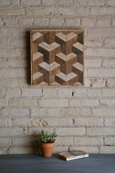 This is a one of a kind wood lath art piece that is 14 1/2 wide by 15 1/4 high and 1.5 deep. The frame is made from the same material. It can
