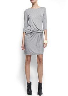 Figure flattering, this Mango draped dress can easily be worn during the day and night. Add a leather jacket and chunky accessories for a night out.  £29.99