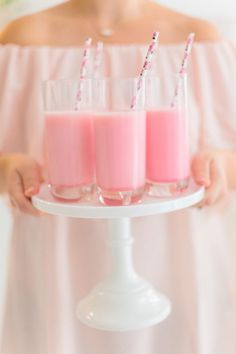 Strawberry milkshakes with decorative straws: http://www.stylemepretty.com/living/2017/02/03/a-flower-and-tutu-inspired-tea-party-for-the-littlest-loves/ Photography: Andrew & Jade - http://andrewjadephoto.com/