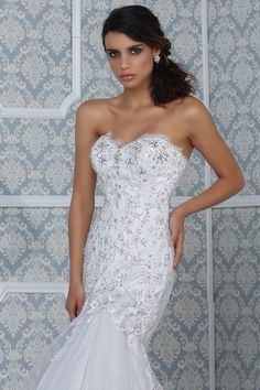 Figure hugging gown by Impression Bridal
