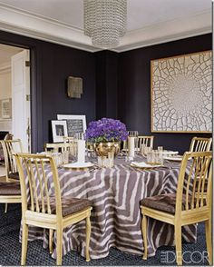 Dining room combines my 2 favorite colors... gold and purple.. and its a fun table cloth!