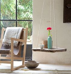DIY Table Swing. Can easily be made from a pallet too. Drill 3 Holes (or 4, if you like), take some rope and hang it with a hook under the ceiling.