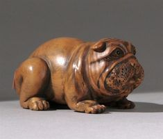 Buy online, view images and see past prices for WOOD NETSUKE By Gyokumatsu. In the form of a reclining dog with comic expression and inlaid eyes. Japanese Pottery, Japanese Art, Asian Sculptures, Wood Carving Art, Japanese Characters, Glazes For Pottery, Old Art, Asian Art, Sculpture Art