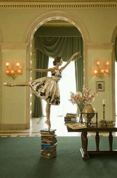 En Pointe on books- I love everything about this; the dance, the dress, the room, the books, the globe, the green colors, and the total absurdity of it all
