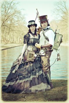 Elfia Steampunk Couple - For costume tutorials, clothing guide, fashion inspiration photo gallery, calendar of Steampunk events, & more, visit SteampunkFashionGuide.com