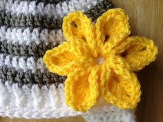 This flower works up quickly and is adorable when added to any kind of headband, hat, purse, whatever you want to add a little flare to!