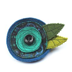 Harris Tweed corsage handmade with freehand embroidery and a Rarebird ceramic button. Fabric Brooch, Felt Brooch, Textile Jewelry, Fabric Jewelry, Textile Art, Free Motion Embroidery, Beaded Embroidery, Fabric Gifts, Handmade Accessories