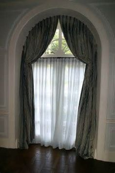 Home Made Arch Window Covering To Stop The Sun From Coming