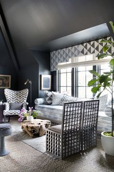 layered patterns in a new traditional living room setting by cloth & kind…