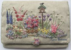 In an English Country Garden Needlecase Pattern kit by lornabateman22, $39.95 for experienced embroiderer. Screened on fabric. All fabrics supplied; must be sewn once embroidered.  (Someday, I dream of being good enough to do this beautiful piece.)