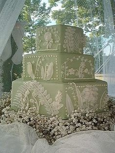 Beautifully detailed three tier lily of the valley wedding cake.  ᘡղbᘠ