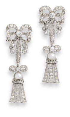 [EARRINGS ONLY] A pearl and diamond brooch and earring suite, first half of the 20th century  mounted in platinum, diamonds approximately 6.00 carats total, pearls untested, later fittings, length of brooch 8.6cm, cased by J M Stigner, 5 Cheriton Place, Folkestone.