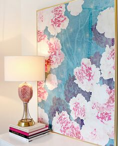Beautiful pink and blue floral print with stacked books and a lamp on top, great source of light #dream #divine #decor