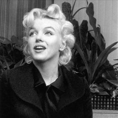 """Marilyn Monroe at a press conference on her return to Los Angeles to film """"Bus Stop"""". Photo by Leigh Weiner, February 25th 1956."""
