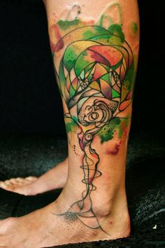 This beautiful tattoo by Petra shows a woman becoming a tree of life with colorful foliage and an elegant pose