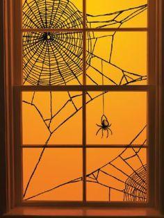Yarn spider web window dressing
